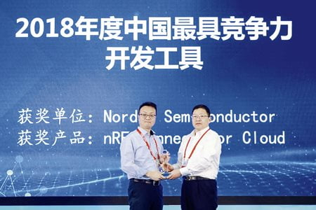 Damien Wong, Regional Sales Manager for South China, Nordic Semiconductor (left) receives the award from Chen Wenhai, General Manager, China Electronic Appliance Co., Ltd.
